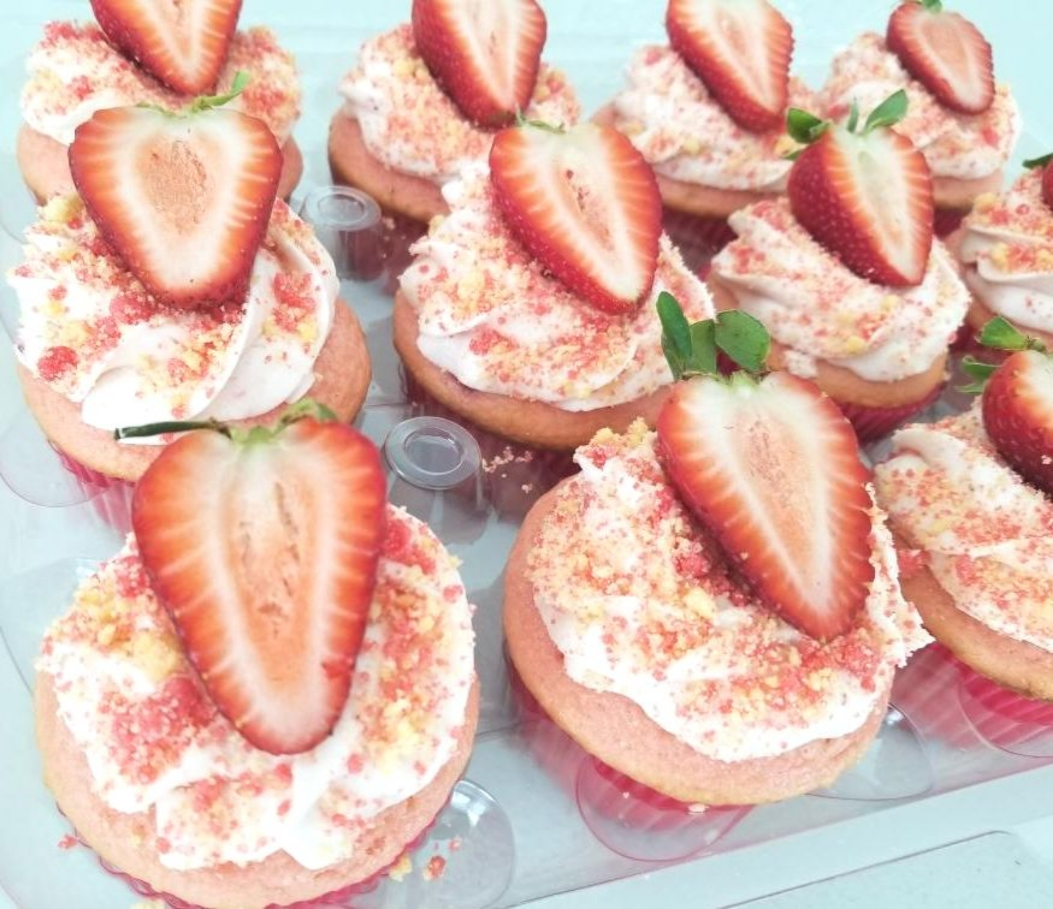 Strawberry Shortcake Cupcakes topped with Strawberries