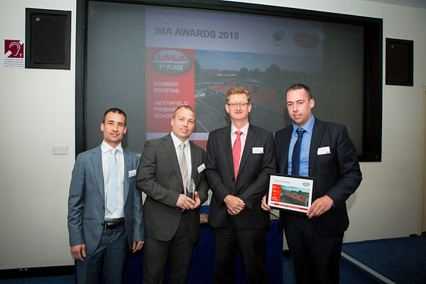 Jon & David Hammersly collecting award from Icopal MD Matthew Scoffield