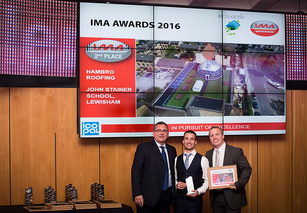 Jon & David Hammersley collecting award from Neil Harrison