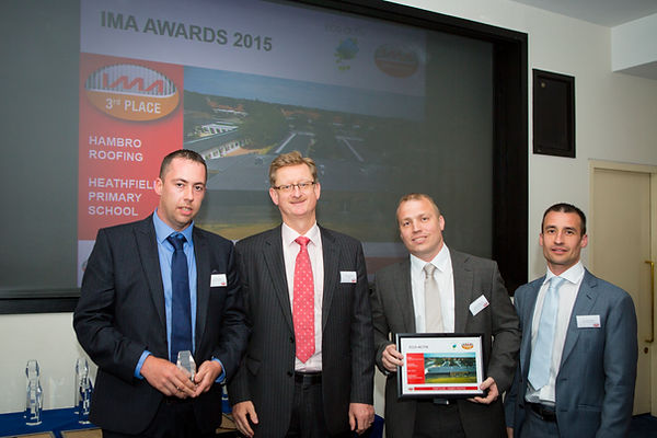 Jon & David Hammersley collecting award from Icopal MD Matthew Scoffield