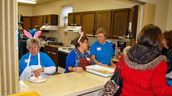 """Volunteers Helping in the Kitchen for """"Savor the Seasons."""""""