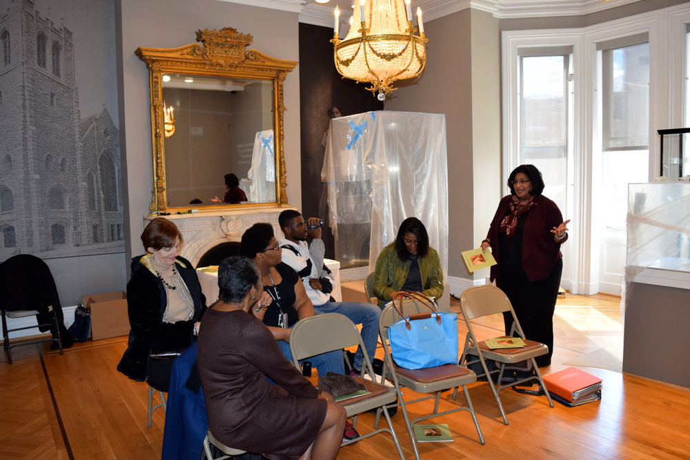 IRIS L. BARNES, CURATOR, TALKING TO THE STUDENTS AT THE LILLIE CARROLL JACKSON CIVIL RIGHTS MUSEUM. PHOTO COURTESY OF NANNY JACK & CO.