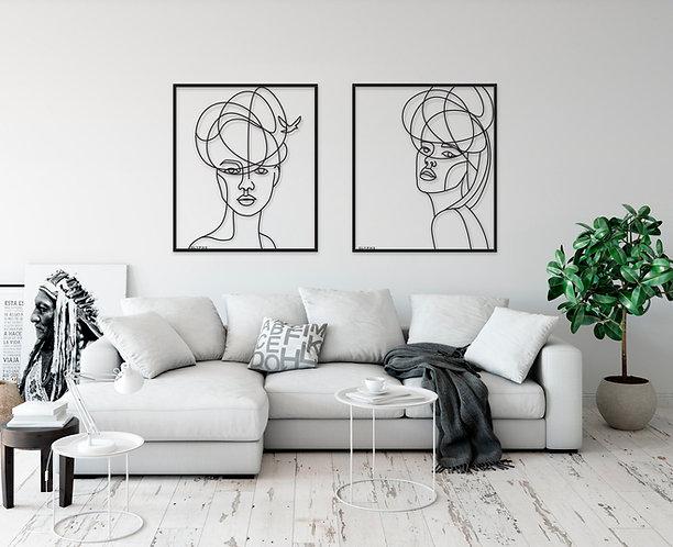תמונות של זוג נשים תלויות על הקיר