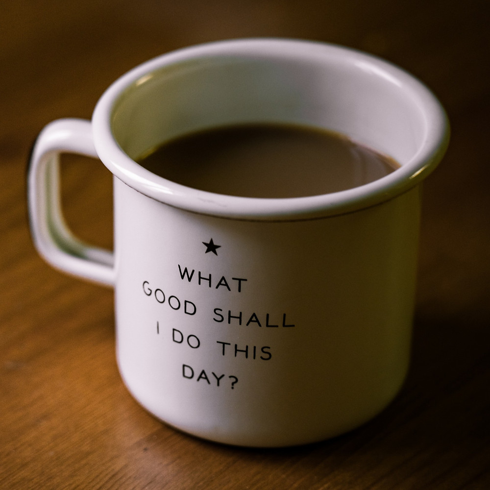 cup of coffee with inscription: what good shall I do this day?