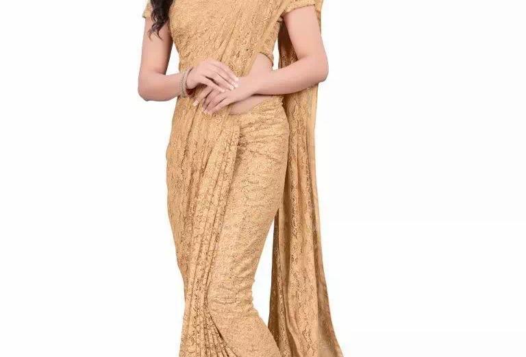 beige net embroidery saree