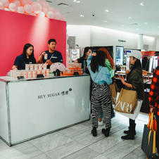 Fans waiting to get their drink at Holt Renfrew event