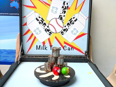 Milk-Cans-Tossing-Game.jpg