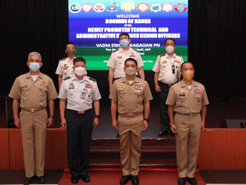 37 Newly-promoted Senior TAS Officers don ranks