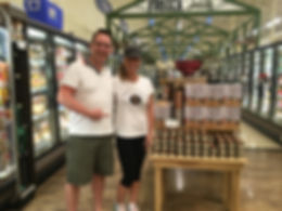 Brandy and her husband, Lee, with the Brandy's Soy Candles display at Lowes Foods