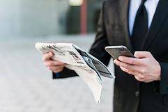 business-man-using-his-mobile-phone_edit