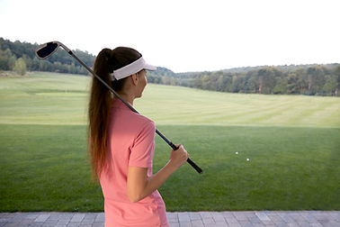 Mädchen mit Golfclub