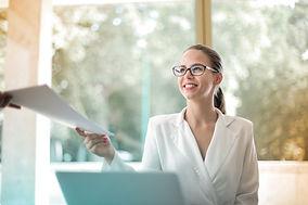 positive-businesswoman-doing-paperwork-i