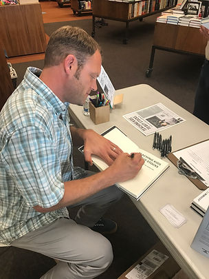 Warwicks Book Signing Action Photo