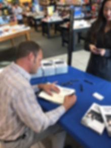 JJ Signing a book at Barnes & Noble in F