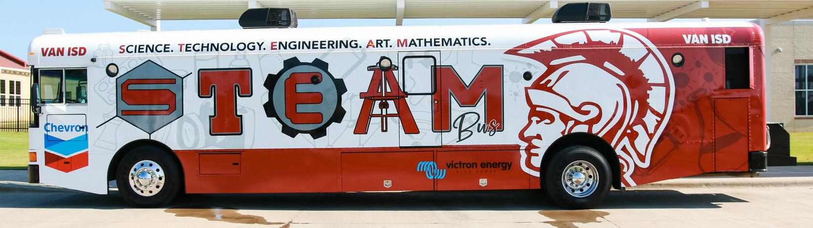 Van ISD STEAM Bus  Drivers side.jpg