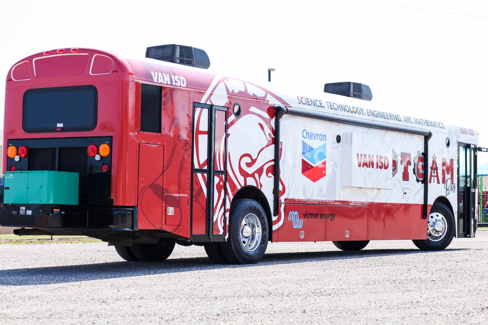 Van ISD STEAM Bus-passenger side.jpg