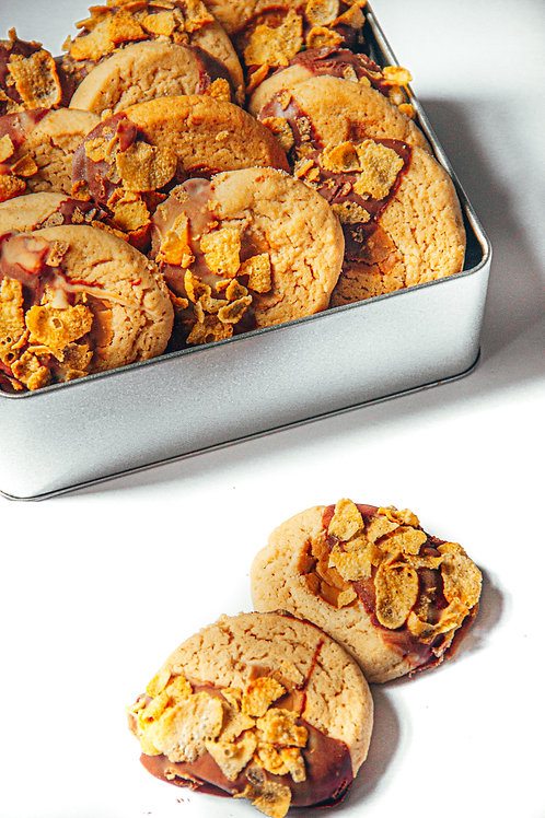 Biscoff Cream Cookies with mylk and white chocolate topped with cornflakes