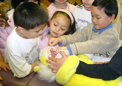 San Jose dentist for children shows kids the best way to floss
