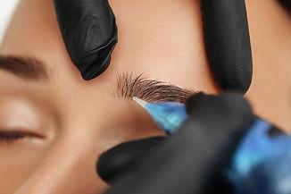 Cosmetologist%20applying%20permanent%20make%20up%20on%20eyebrows-%20eyebrow%20tattoo_edited.jpg