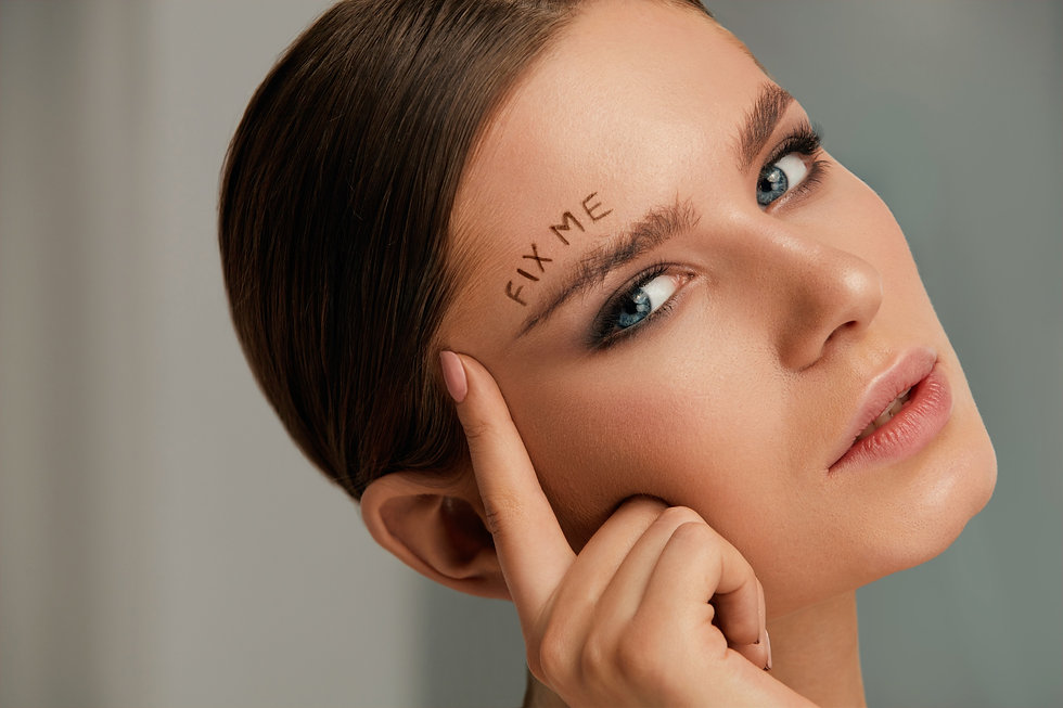 Beauty%20makeup.%20Woman%20face%20with%20messy%20eyebrow%20and%20fix%20me%20sign%20on%20skin%20close