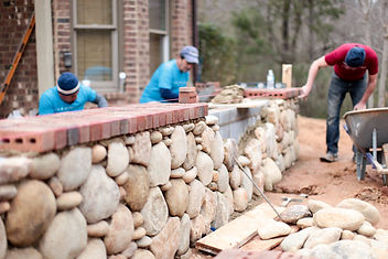 river rock veneer, river rock wall, brick cap, stonemasonry, landscape design, design and build, rustic garden design
