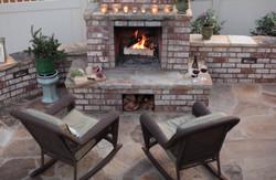 brick/stone patio, outdoor fireplace