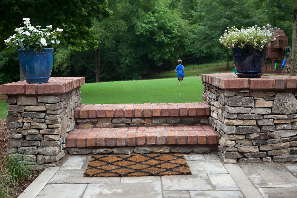 fieldstone columns+steps, brick cap