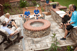 fieldstone fire pit and seat wall