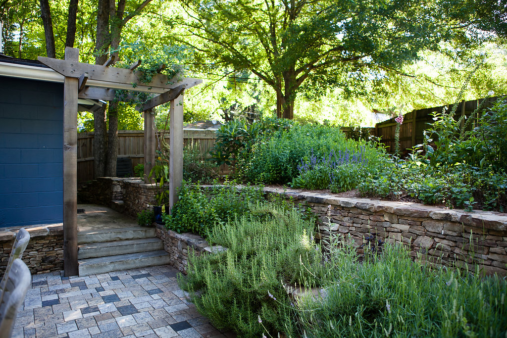 terraced fieldstone walls with herbs