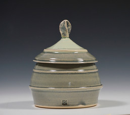 small lidded jar-pinched rounded top.jpg