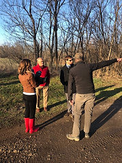 Advocates explaining the efforts to sav Floyds Fork with WDRB.