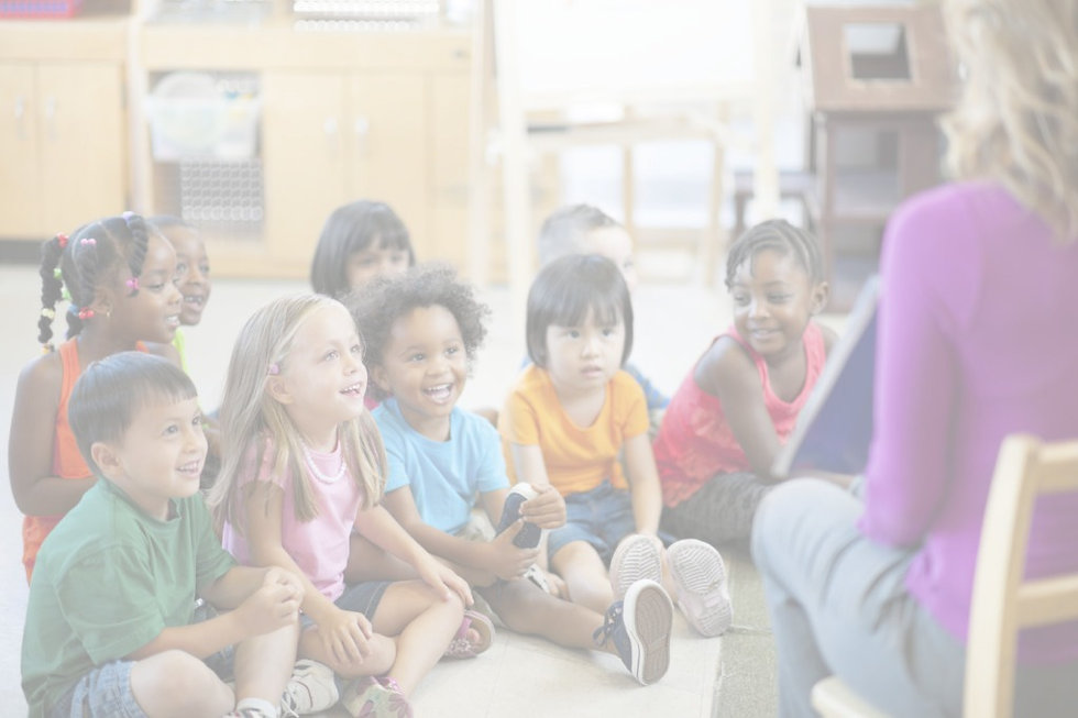 Children sitting and listening at school.
