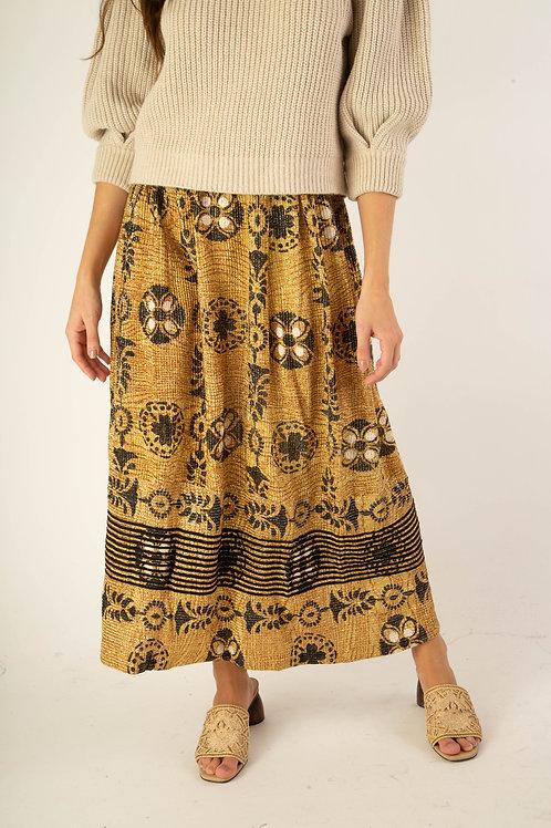 Saia ouro com detalhes arabesco preto