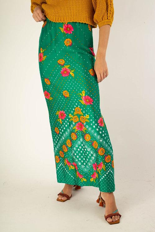 Saia verde com flores coloridas