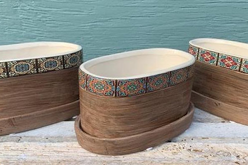 Oblong ceramic planter with mosaic pattern