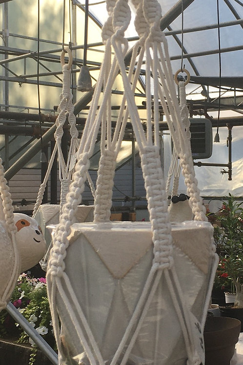 Macrame plant hanger with geometric shaped pot