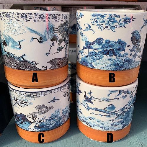 White pot with blue scene and terracotta base stripe