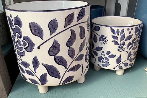 Set of white pots with blue flowers
