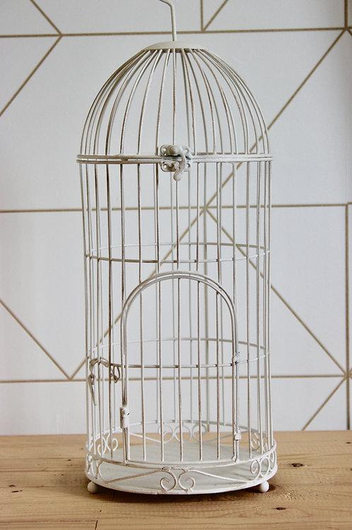 Cage à oiseaux blanche avec détails