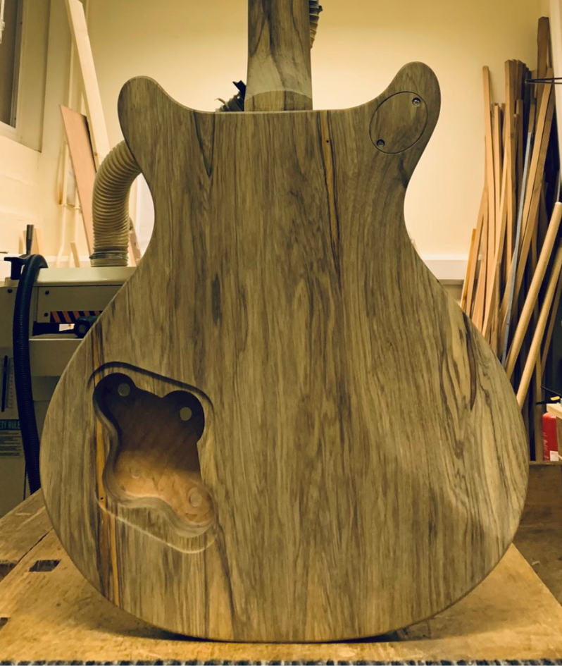 Routed, carved and shaped guitar back