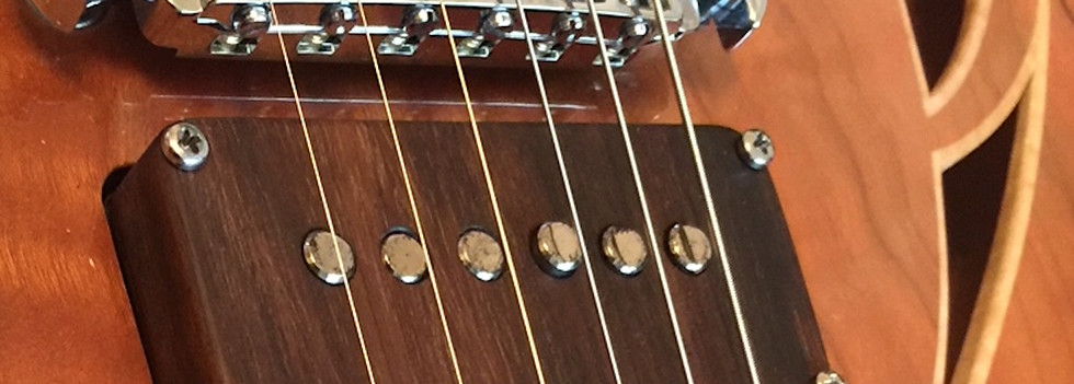 semi holow rosewood pick up covers and sound holes