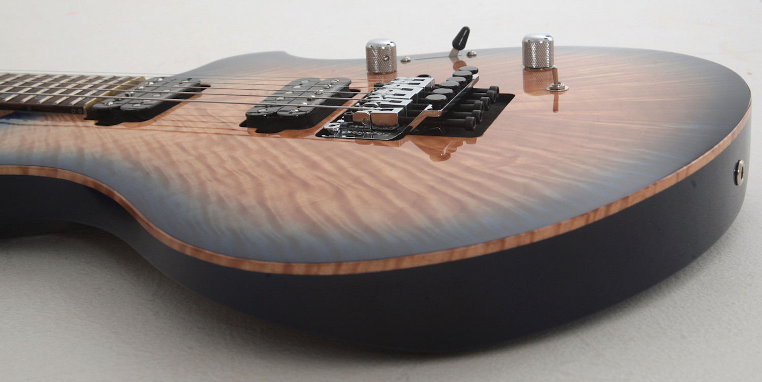 custom electric guitar design with curved top