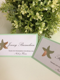 Paper Love Invites | matching tent style place cards in mint with silver foil stars