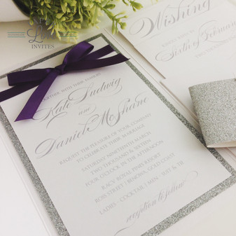 Paper Love Invites   Pearlescent white pocket invitations with silver glitter and ribbon