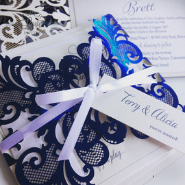 Paper Love Invites   metallic blue laser cut invitations