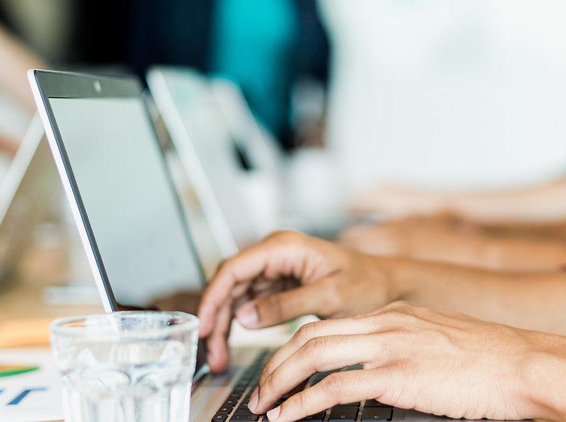 hands-typing-computer-meeting.jpg