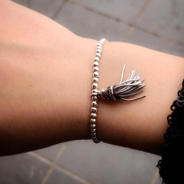 Bracelet élastique + pompon argent