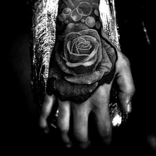 hand tattoo rose trenchart amsterdam.jpg