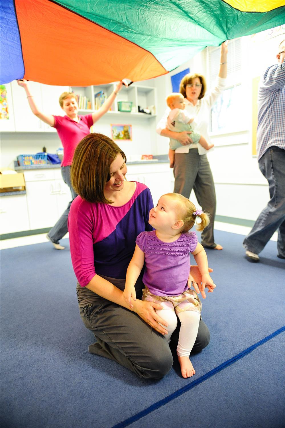 Photo-Kindermusik-YoungToddler-Mom-Girl-Parachute-Play.jpg