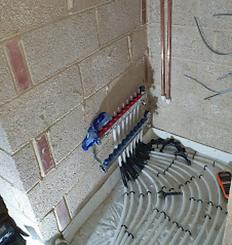 Underfloor pipe junction.